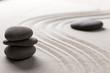 zen stone garden round stone and raked sand
