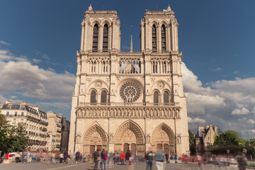 Notre Dame de Paris. France. Ancient catholic cathedral on the quay of a river Seine. Famous touristic architecture landmark in spring