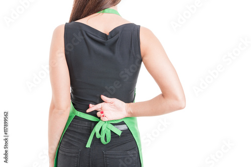 Fotografija  Woman employee with finger crossed behind her back