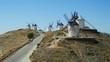 Consuegra, Spain - June 2016: Tourists next to a windmills of Castilla la Mancha, Spain. Windmills at Consuegra