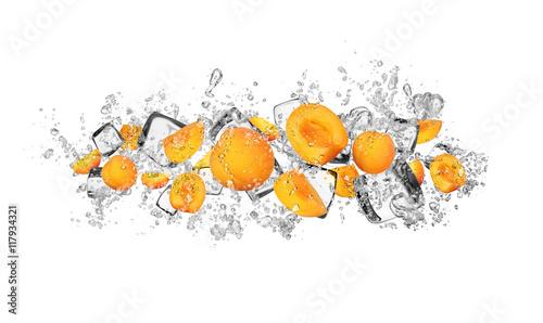 Fototapeta Apricots in water splash on white background obraz na płótnie