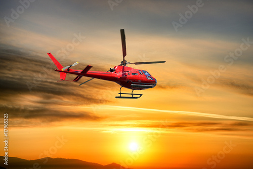 plakat Helicopter Flying at sunrise