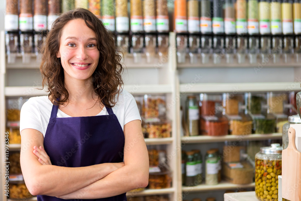 Fototapeta Young attractive woman working at the grocery store