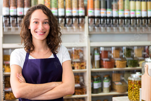 Young attractive woman working at the grocery store Canvas-taulu