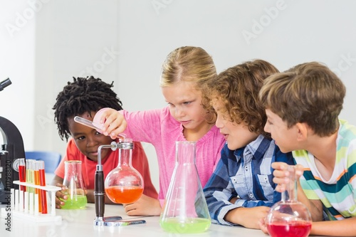 Fotografie, Obraz  Kids doing a chemical experiment in laboratory