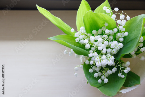 Wall Murals Lily of the valley on wooden background. the bouquet.