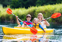 Family Enjoying Kayak Ride On ...