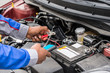 Mechanic Hands Using Multimeter For Checking Battery
