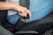 Female's Hand Sitting Inside Car Fastening Seat Belt