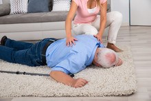Woman Looking At Her Fainted D...