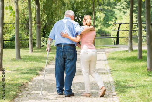 Wallpaper Mural Woman With Her Disabled Father Standing In Park