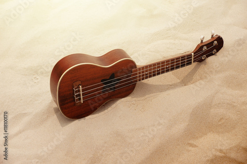 Photo  Ukulele Guitar on the Sand Beach in Summer Time