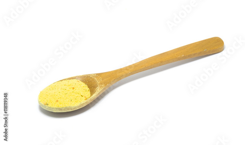 Photo  wooden spoon with vegeta spice isolated on white background.