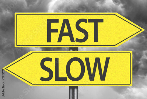 Photo  Fast x Slow yellow sign