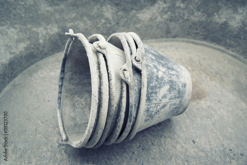 Photo  cement  mix with spatula tool in bucket