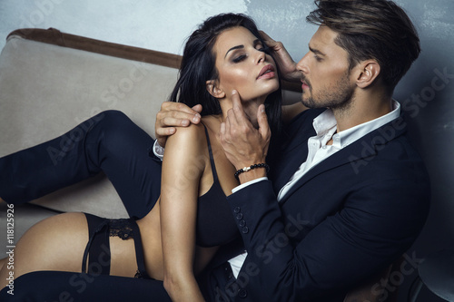 Fotografie, Tablou  Sexy couple on coach