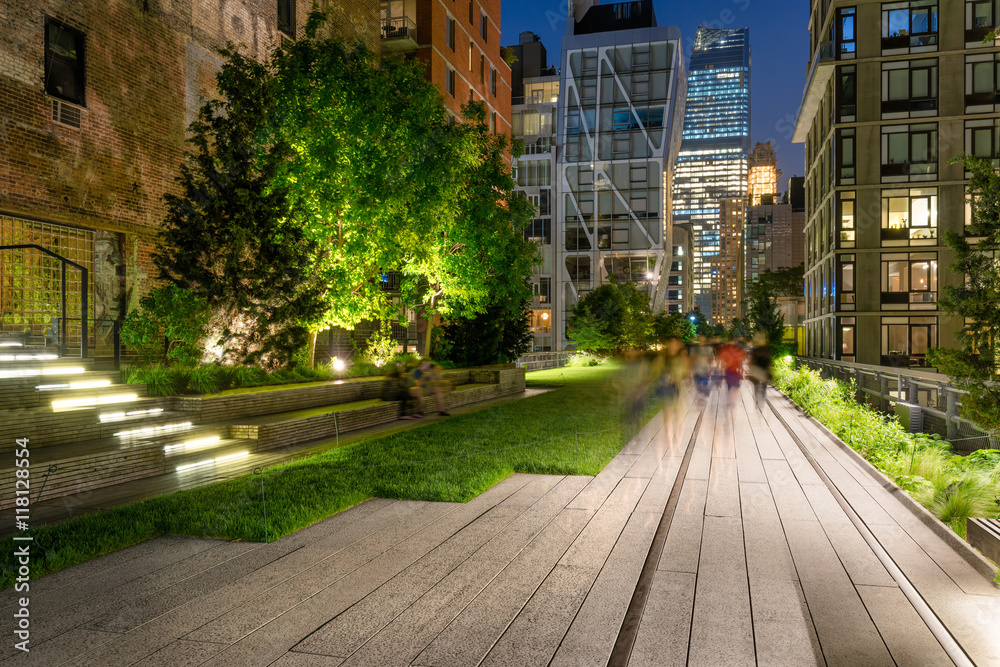 Fototapety, obrazy: The High Line promenade illuminated at twilight surrounded by modern and older buildings in Chelsea. The aerial greenway is also known as Highline or High Line Park. Manhattan, New York CIty