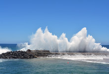 Wave Breaking On A Harbour