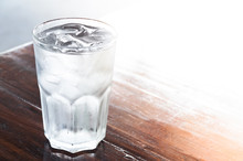 Glass Of Water With Ice On Wooden Table , Clean Water,drinking Water