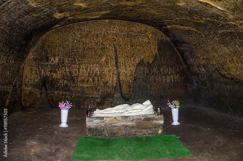 Rooms carved into the rock with doors and windows in the cave monastery in the Carpathian foothills Rozhirche