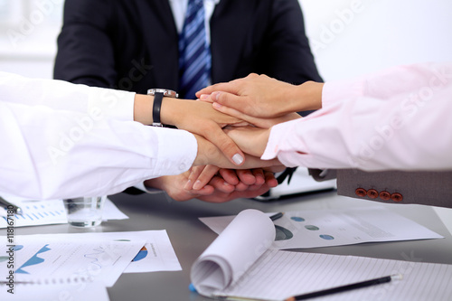 Fototapety, obrazy: Business people group joining hands and representing concept of friendship and teamwork