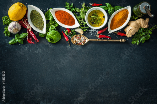 Printed kitchen splashbacks Spices Herbs and spices over black stone background