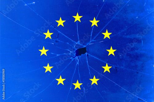 Fotografie, Obraz  EU flag with broken glass background, Braking European Union or EU concept
