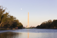 Looking Eastwards Across The Lincoln Memorial Reflecting Pool & The Grand Ceremonial Tree-lined Boulevard Of The National Mall Towards The Washington Monument At Twilight, Washington DC