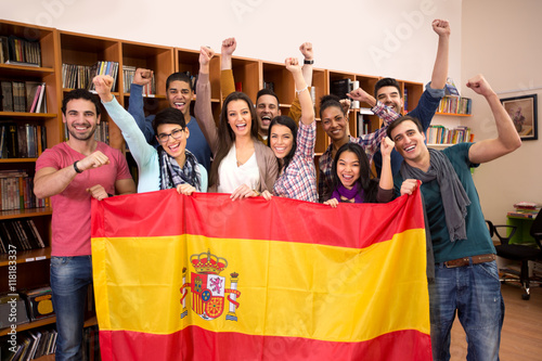 Team of excited Spanish students with victory smile Wallpaper Mural