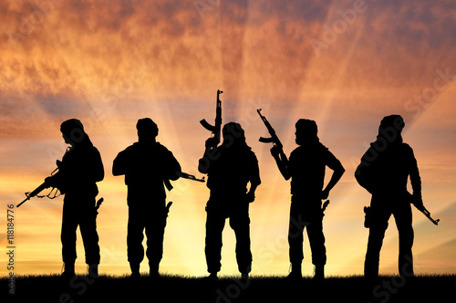 Foto op Canvas Jacht Armed terrorists at sunset