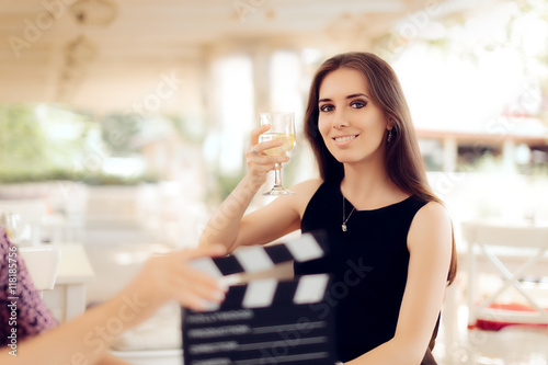 Photo  Happy Actress Holding a Glass in Movie Scene