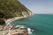 View of ocean, rocky coastline and lush cliff at the Taejongdae Resort Park in Busan, South Korea.