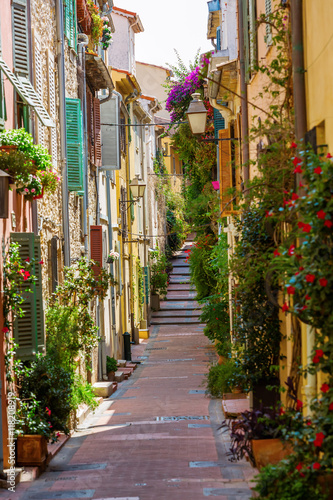 alley with entwined houses in Antibes, France Canvas Print