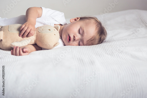 Baby sleep with plush toy