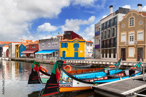 Vászonkép Moliceiro boats docked along central canal in Aveiro, Portugal