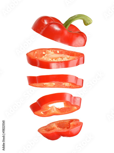 Fotografie, Obraz  sliced and falling red pepper isolated on white background