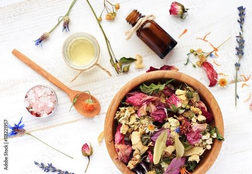 Photo  Herbal blend of various dried medicinal flowers, essential oil, bottle, sea salt