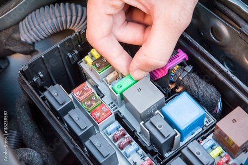 hand checking a fuse in the fuse box of a modern car engine buy fuse box wiring hand checking a fuse in the fuse box of a modern car engine