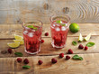 fruit lemonade with raspberries and ice, lime and mint