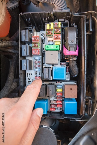 hand checking a fuse in the fuse box of a modern car engine buy modern day fuse box hand checking a fuse in the fuse box of a modern car engine