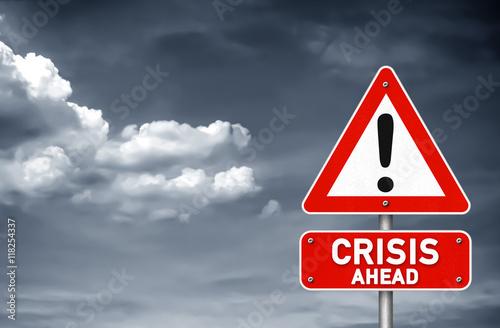 Fotografía  Crisis ahead road sign warning