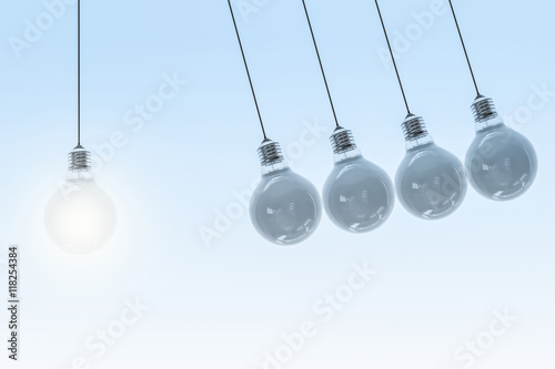 Canvas Print Newton´s Cradle - swinging bulbs