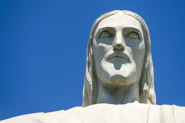 Fototapeta Close-up portrait of the face of Christ the Redeemer at Corcovado against blue sky in Rio de Janeiro Brazil
