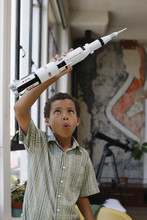 Boy Playing With Model Rocket