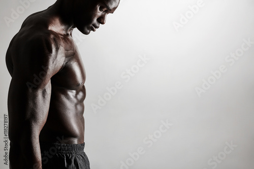 Fotografie, Obraz  Torso of a muscular man with copyspace