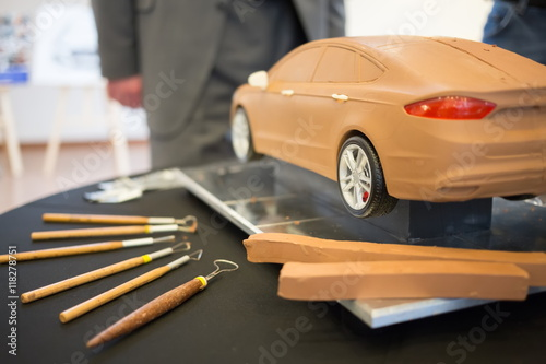фотография  Ford car model made of clay, is on the table, next to lay tools at the press event for Ford in SREDA loft