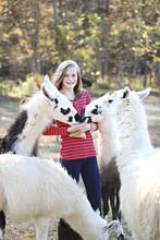 Caucasian Girl Feeding Livestock On Farm