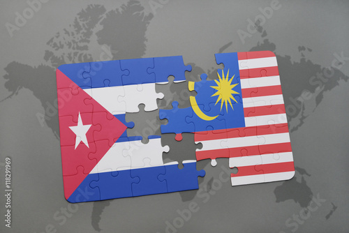 Photo  puzzle with the national flag of cuba and malaysia on a world map background