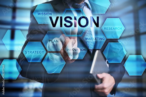"""Fotografía  Businessman is pressing on the virtual screen and selecting """"Vision"""""""