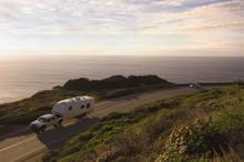 Truck Pulling Camper On Coastal Highway
